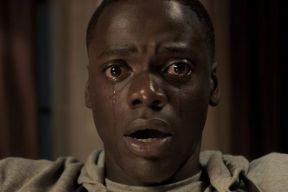 Scene from the film Get Out. The black main character is crying after a revelation.